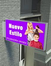 banderolas-publicitarias Las banderolas luminosas a dos caras sobre la fachada
